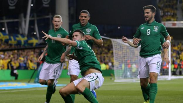 Robbie Keane begins his trademark celebration after giving the Republic of Ireland the lead in their Group C qualifier