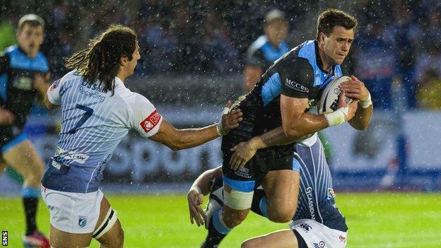 Glasgow Warriors' Alex Dunbar is tackled by Cardiff duo Josh Navidi and Gavin Evans