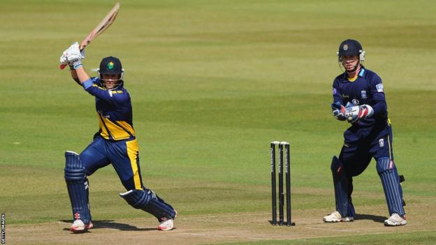 Glamorgan captain Mark Wallace drives to the boundary as Hampshire wicketkeeper Adam Wheater looks on during the YB40 semi-final at the Ageas Bowl.