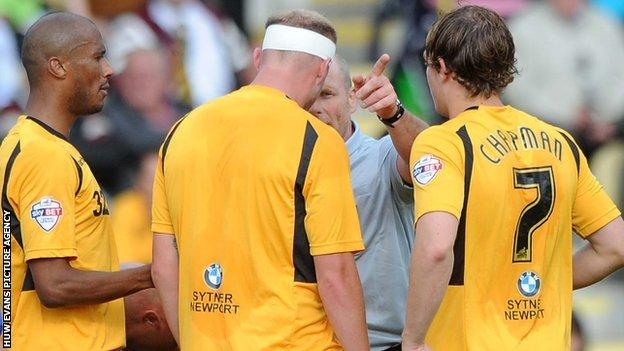 Referee Dave Phillips sends off Lee Minshull of Newport County