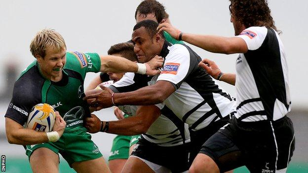 Connacht's Fionn Carr tries to fend off Kameli Ratuvou of Zebre