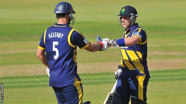 Jim Allenby is congratulated on reaching his 50 by batting partner Ben Wright during Glamorgan's win over Hampshire