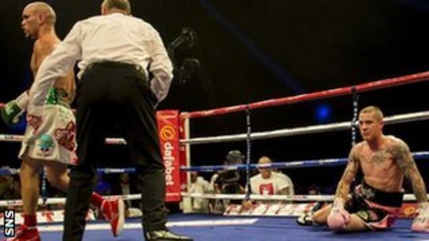 Ricky Burns is sent to the canvas by Raymundo Beltran