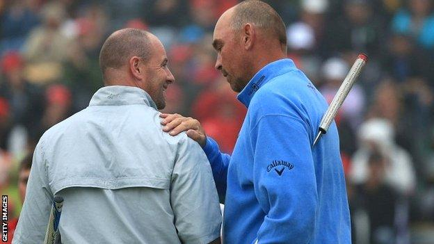 Thomas Bjorn (right) consoles Craig Lee after his play-off win at the European Masters