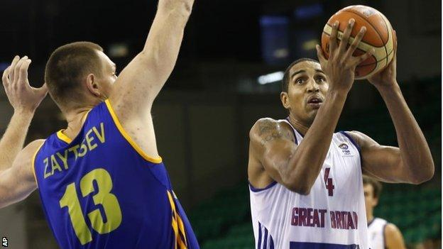 Britain's Kieron Achara, right, challenges for the ball with Ukraine's Ihor Zaytsev