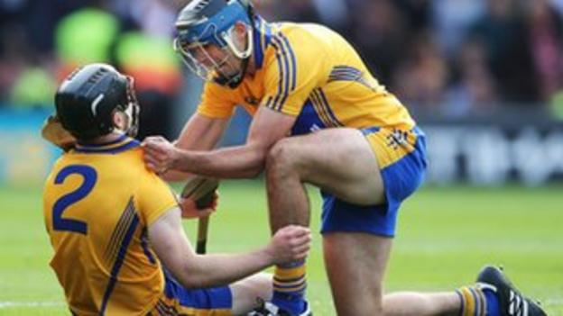 Domhnall O'Donovan is congratulated by Brendan Bulger after his last gasp equalizer earns Clare a replay in All-Ireland hurling final