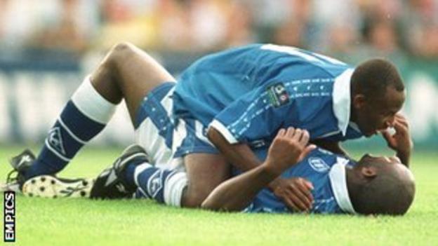 Dele Adebola celebrates one of his 136 career league strikes with Birmingham co-striker Peter Ndlovu
