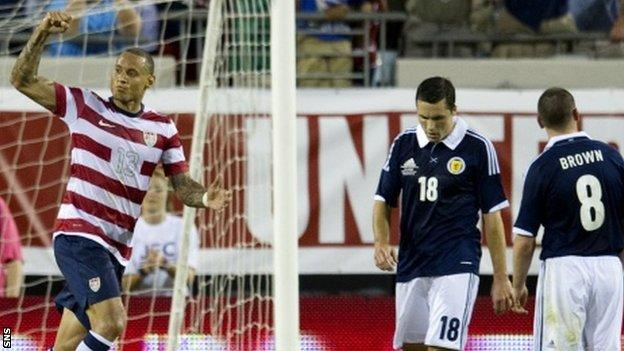 Jermain Jones celebrates scoring against Scotland