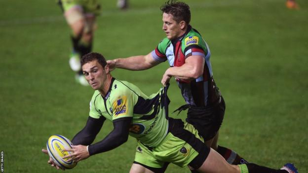 Northampton wing George North is halted by Harlequins' Tom Williams in the Saints' 13-6 Aviva Premiership win at The Stoop