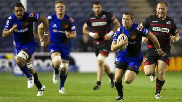 Richie Rees scores a try against his former team as the Dragons battle hard