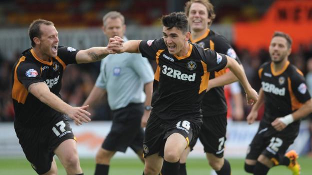 Billy Jones celebrates scoring just two minutes into his debut for Newport County against Morecambe at Rodney Parade. But the match ended in a 3-2 defeat for Newport.