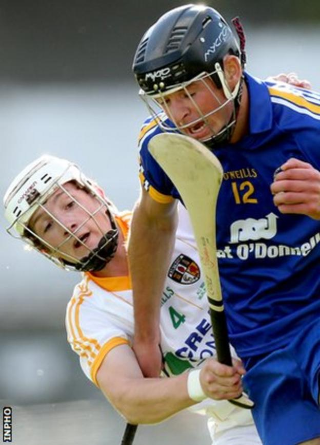 Antrim's Tiernan Coyle battles with Clare's Cathal Malone at Thurles