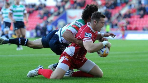 Scrum-half Gareth Davies scores the first of his two tries in the Scarlets 26-10 win against Treviso in the Pro12.
