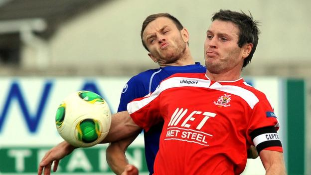 Michael McKerr and Kevin Braniff in action as second-placed Portadown defeat Dungannon Swifts 2-1