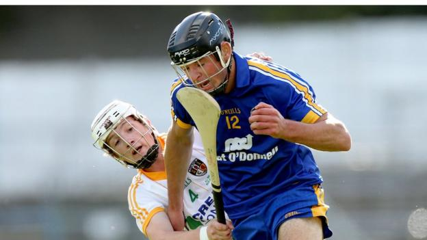 Tiernan Coyle and Cathal Malone vie for possession as Clare outclass Antrim in the Under-21 hurling decider at Semple Stadium
