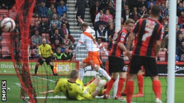 Neal Bishop scores the winning goal for Blackpool at Bournemouth