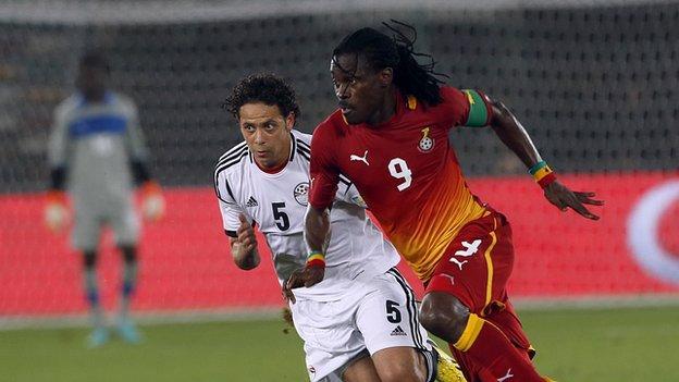 Egypt's Ibrahim Salah (left) fights for the ball against Ghana's Derek Boateng