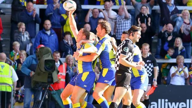 Warrington celebrate a try against Leeds