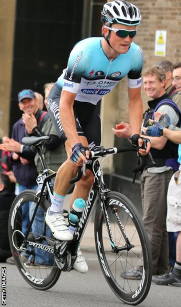 Andy Fenn is applauded by cycling fans in Glasgow at the National Road Race Championships in June