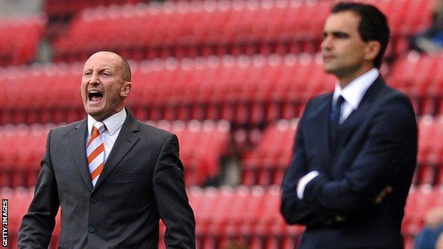 Ian Holloway (left) and Roberto Martinez