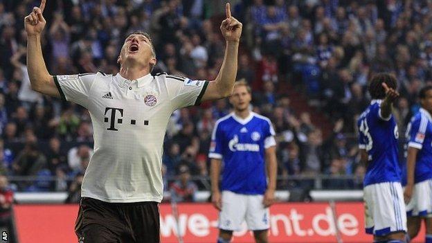 Bayern's Bastian Schweinsteiger celebrates after scoring during the German first division Bundesliga soccer match between Schalke 04 and Bayern Munich