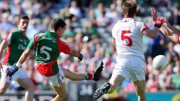 Tommy Conroy shoots in Mayo's goal just before half-time to give them a 1-4 to 0-6 lead at the interval