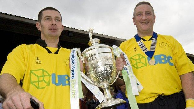 Victor Smith and James Clark (right) celebrate Fort William's cup success in 2007
