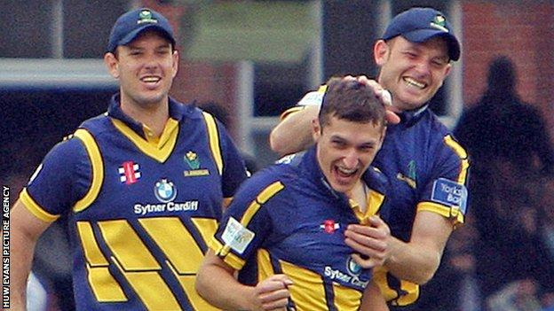 Andrew Salter celebrates a wicket with Jim Allenby (left) and Graham Wagg