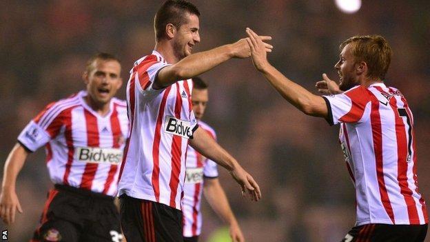 Valentin Roberge celebrates with team-mates