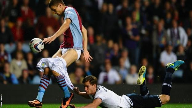 Jan Vertonghen of Tottenham Hotspur hangs on to the shorts of Nicklas Helenius of Aston Villa during the Capital One Cup third round match between Aston Villa and Tottenham Hotspur at Villa Park on September 24 2013