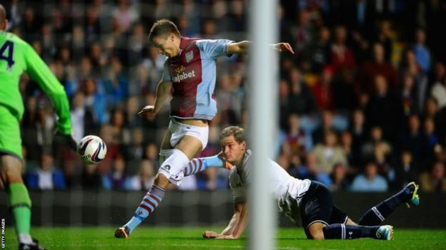Jan Vertonghen of Tottenham Hotspur hangs on to the shorts of Nicklas Helenius of Aston Villa during the Capital One Cup third round match between Aston Villa and Tottenham Hotspur at Villa Park