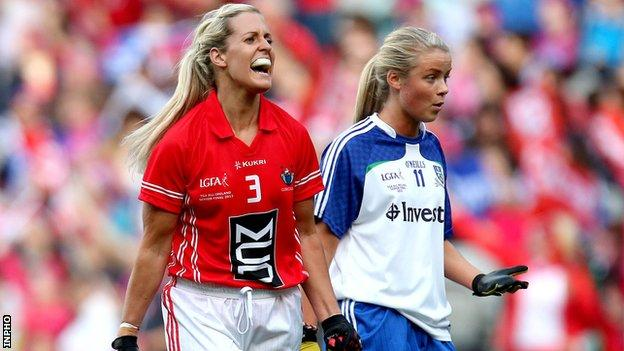 Brid Stack shows her delight after setting up Cork's goal alongside Monaghan's Caoimhe Mohan