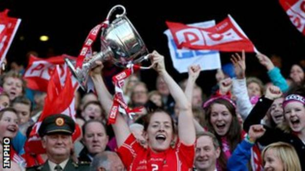 Cork captain Ann Marie Walsh holds aloft the trophy after the game