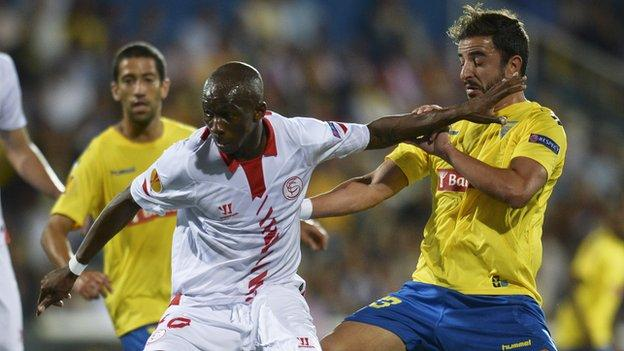 Stephane Mbia (left)
