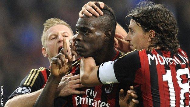 Mario Balotelli celebrates scoring for AC Milan against Ajax