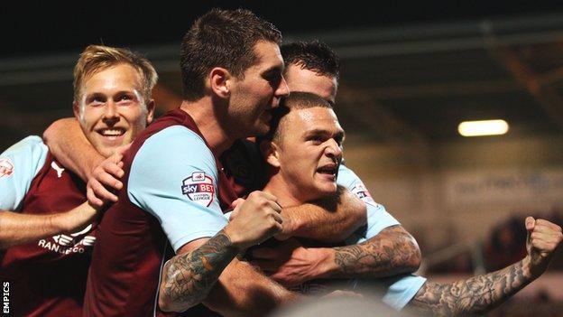 Kieran Trippier celebrates his second goal for Burnley at Doncaster