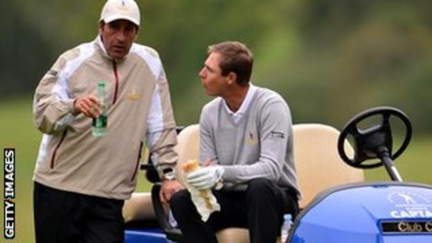 Nicolas Colsaerts of the European team talks with captain Jose Maria Olazabal
