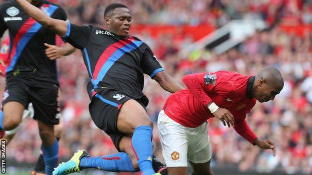 Kagisho Dikgacoi tackles Manchester United's Ashley Young