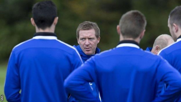 Hearts manager Gary Locke oversees his players in training