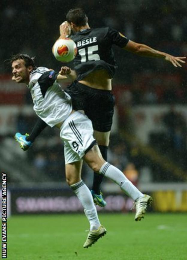 Michu battles for the ball with St Gallen's Stephane Besle