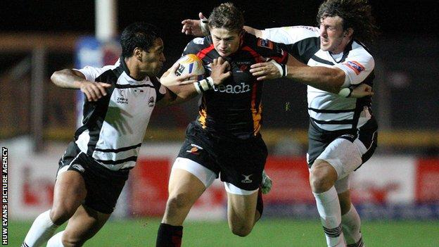 Dragons centre Hallam Amos takes on the Zebre defence