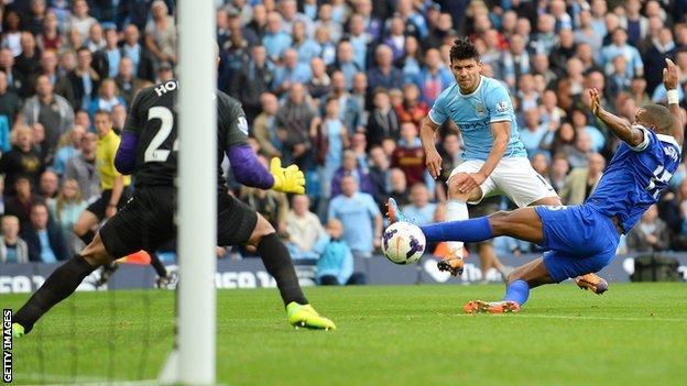Sergio Aguero scores Manchester City's second goal against Everton