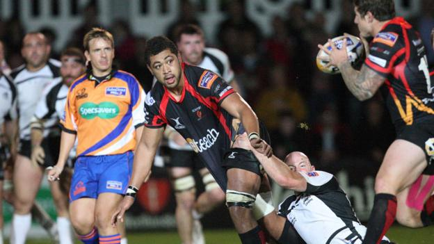 NG Dragons number eight Toby Faletau slips a pass to Ross Wardle during his team's 30-7 win over Zebre in the Pro12.