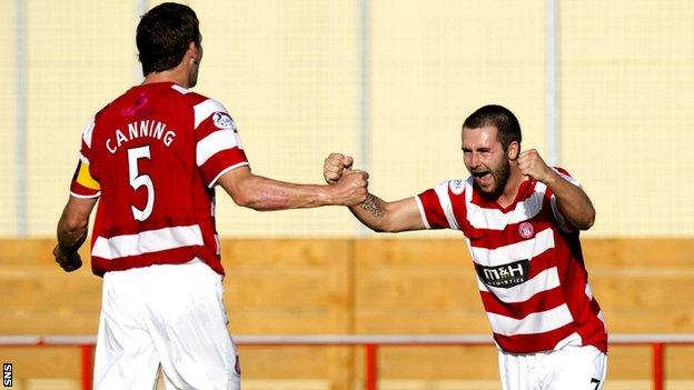 James Keatings celebrates with Hamilton team-mate Martin Canning after scoring against Livingston