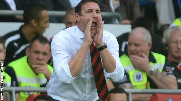 Malky Mackay on the touchlines