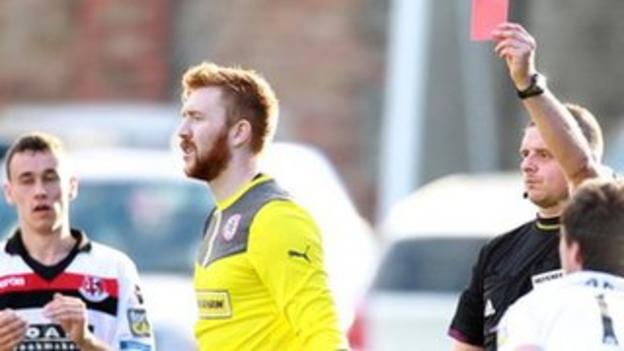 Cliftonville goalkeeper Conor Devlin is sent-off by referee Robert Crangle