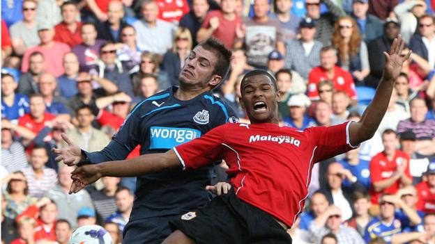 Newcastle's Davide Santon and Cardiff City's Fraizer Campbell clash during the Bluebirds' 2-1 home defeat in the Premier League