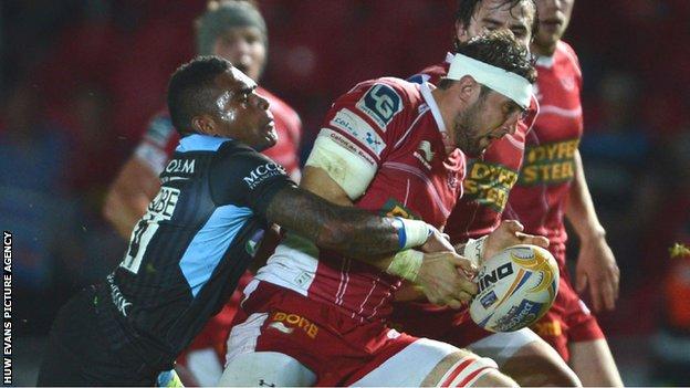 Scarlets forward Josh Turnbull is tackled by Glasgow's Tiko Matawalu