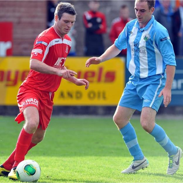 Portadown's Kevin Braniff takes on Padraig Smith of Warrenpoint Town during the Irish Premiership match at Stangmore Park