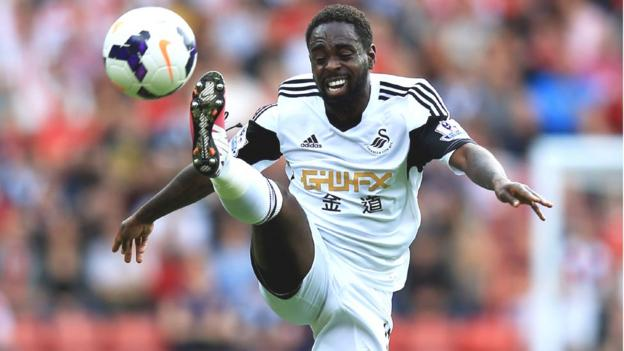 Nathan Dyer strains to control the high bouncing ball during Swansea's Premier League match at Southampton